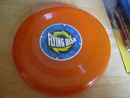 Glittery Orange Plastic Flying Disk