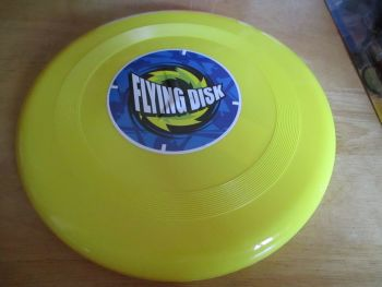 Yellow Plastic Flying Disk