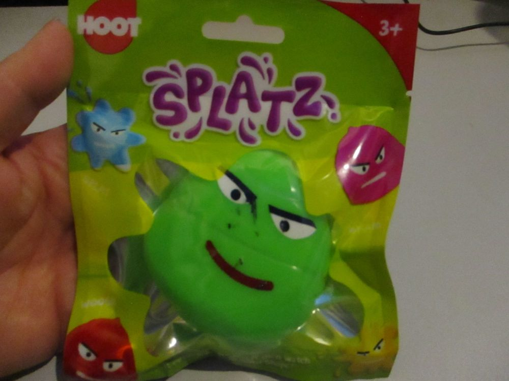 Green Splatz Face Ball Pocket Money Toy