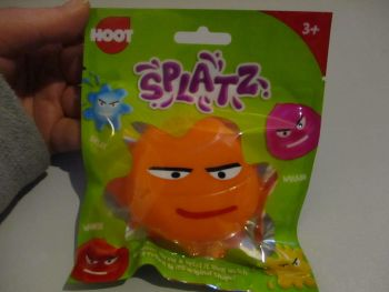 Orange Splatz Face Ball Pocket Money Toy