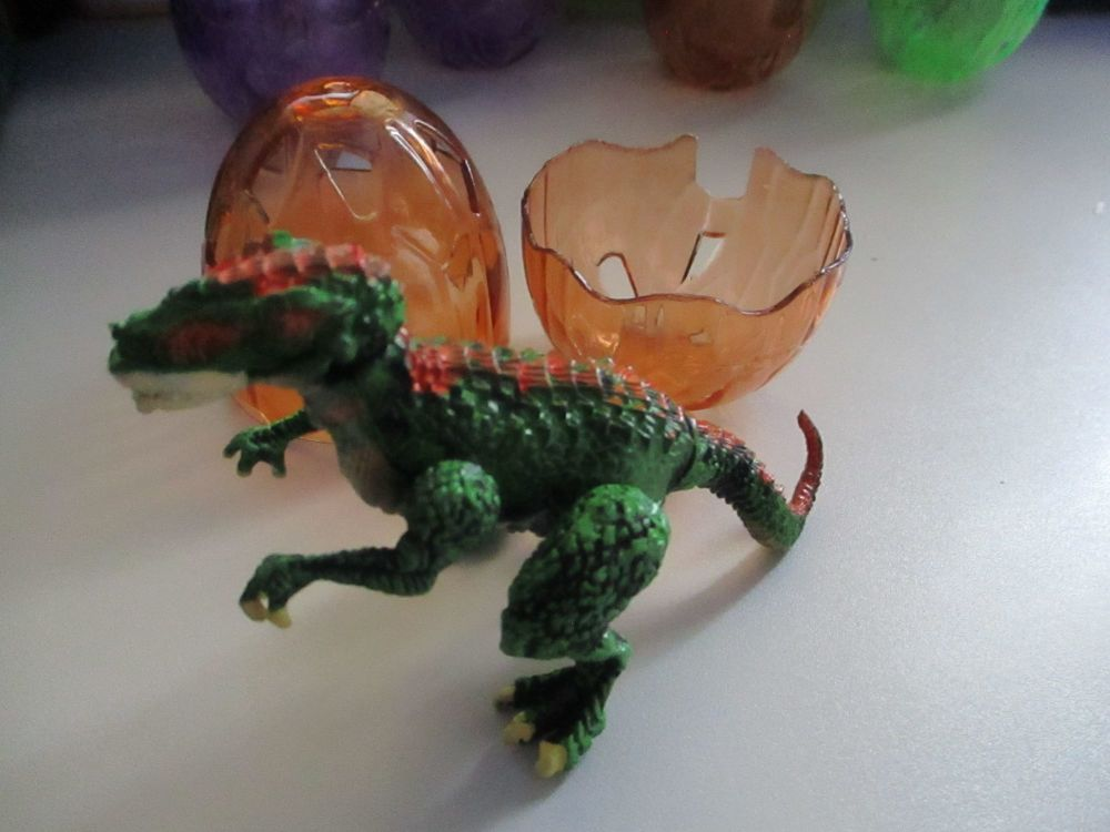 "Allosaurus Dinosaur Construction Toy in ""Cracked Egg"" Case"