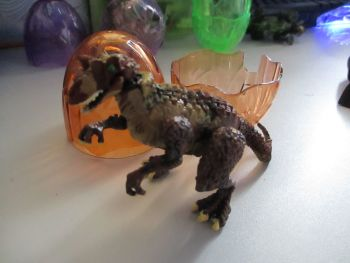 "Carnotaurus Dinosaur Construction Toy in ""Cracked Egg"" Case"