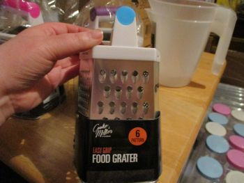 Blue Handled Easy Grip Food Grater – 6 patterns - Cooke & Miller