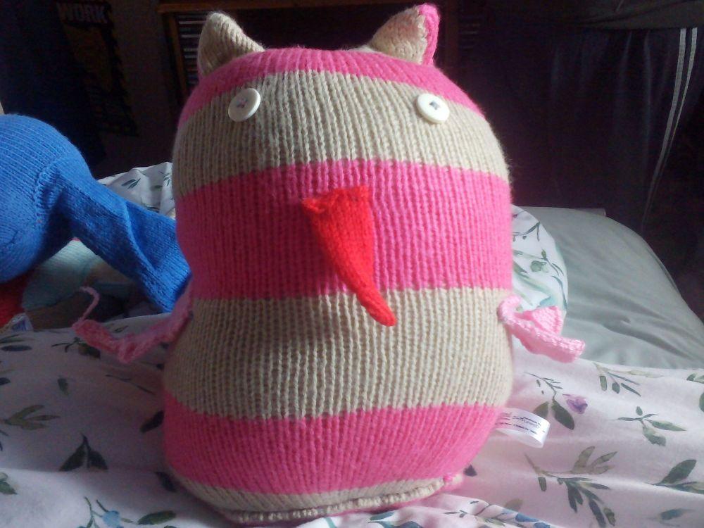 Greyish Brown And Pink Striped White Eyes Pink Wings Red Beak Giant Owl