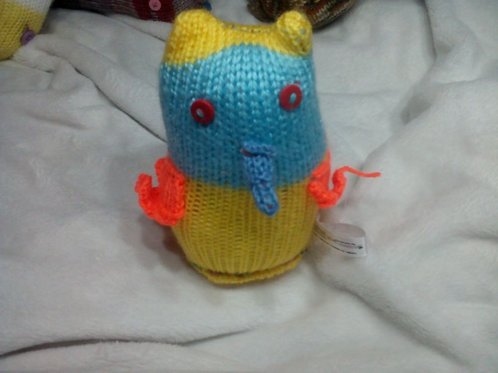 Blue Faced Yellow Midi Owl with Orange Wings, Blue Beak And Red Eyes
