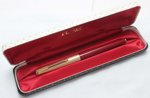 8428 Parker 61 Consort in Rage Red with a Rolled Gold Cap. Fine side of Med