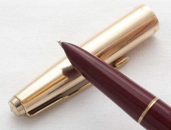 8570. Parker 51 Aerometric in Burgundy with a Rolled Gold Cap, Smooth Broad side of Medium FIVE STAR Nib.