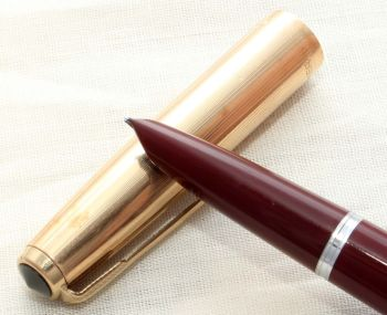 8649. Parker 51 Aerometric in Burgundy with a Rolled Gold Cap, Smooth Medium Oblique Italic FIVE STAR Nib.