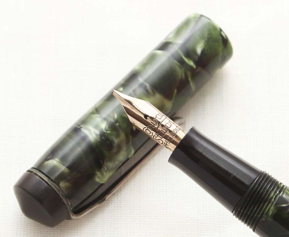 8716 Conway Stewart No.479 in Green Marble. Medium Nib.