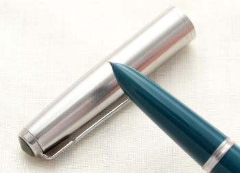8731. Parker 51 Aerometric in Teal Blue with a Lustraloy Cap, Smooth Fine Side of Medium Nib.