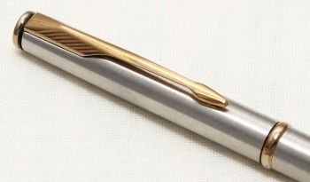 8779 Parker Insignia Ball Pen in Brushed Stainless Steel with gold filled trim..