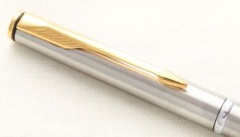 8911 Parker Insignia Ball Pen in Brushed SS with gold filled trim. New Old Stock.