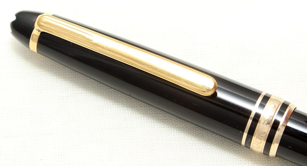 8923 Montblanc 146 Propelling Pencil in Black with gold filled trim. Mint a