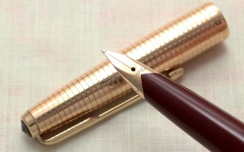 9146 Parker 65 Consort in Burgundy with a Rolled Gold Cap. Medium FIVE STAR Nib. Mint and Boxed.