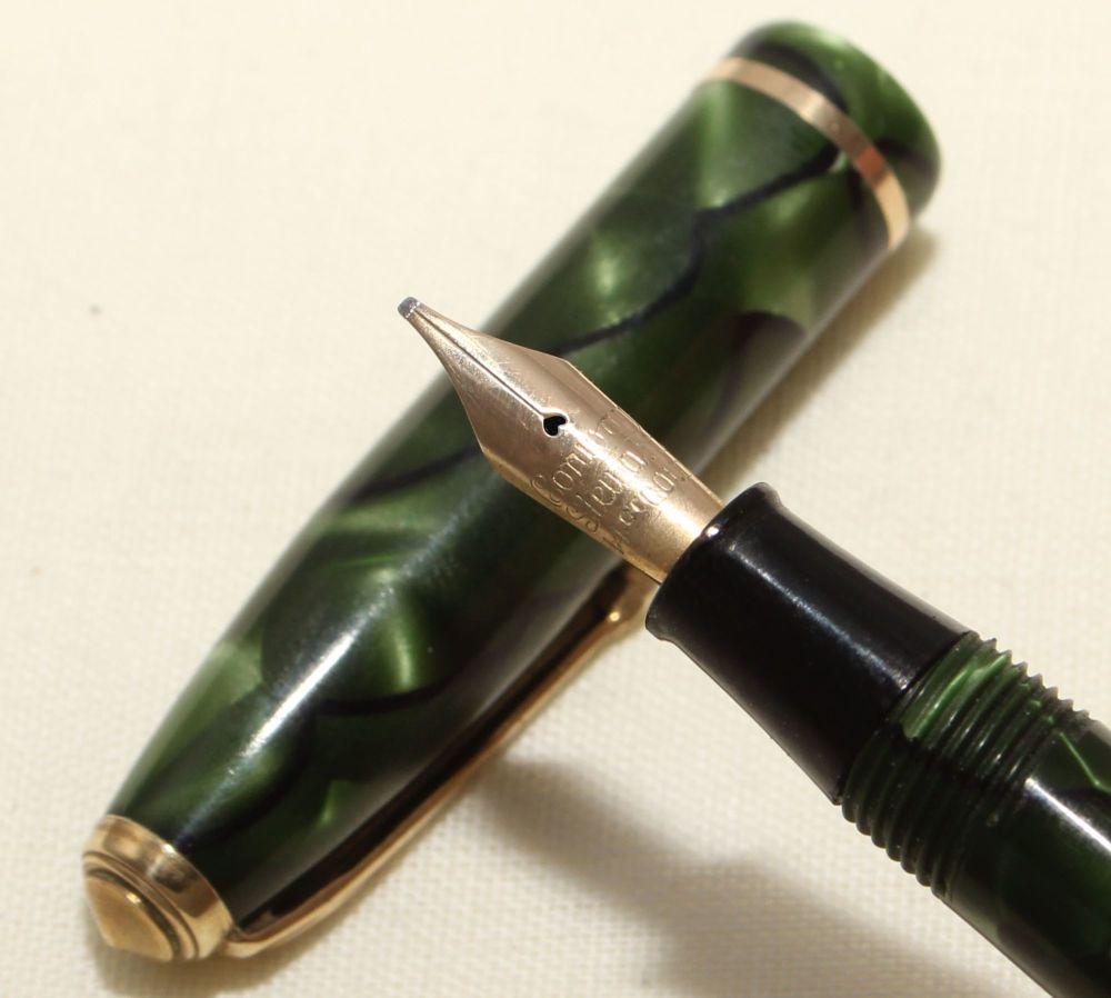 9163 Conway Stewart Dinkie No.560 in Green Marble - Smooth Medium Semi Flex