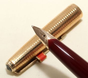 9164 Parker 65 Consort in Burgundy with a Rolled Gold Cap. Medium FIVE STAR Nib. Mint and Boxed.