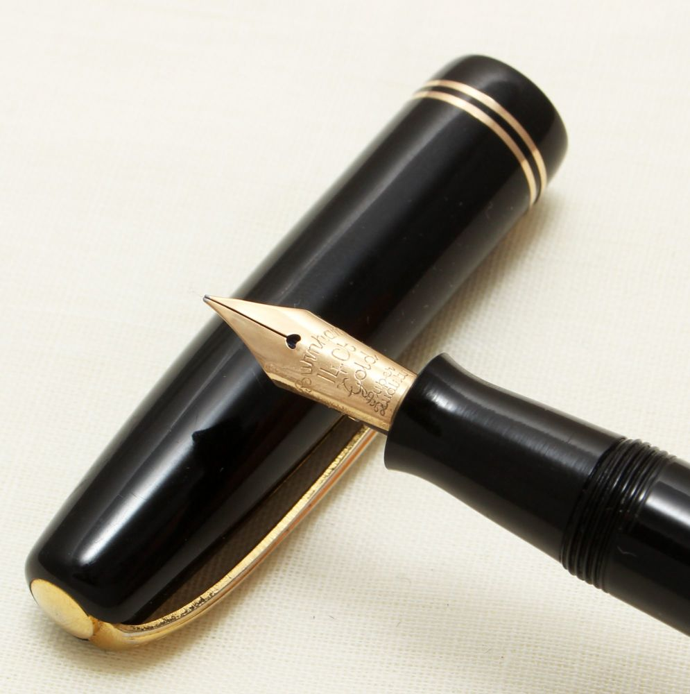 9258 Burnham No.55 in Black with gold Filled Trim. Fine FIVE STAR Nib.