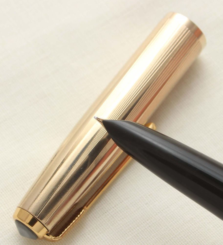 9434 Parker 51 Aerometric in Black with a Rolled Gold Cap. Smooth Fine Nib.