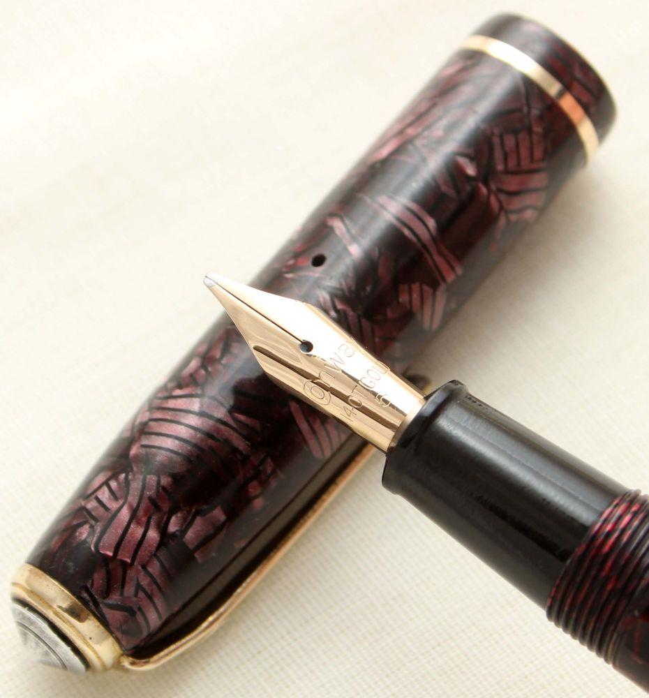 9467 Conway Stewart No.28 in Lined Burgundy Marble. Smooth Medium Italic FI
