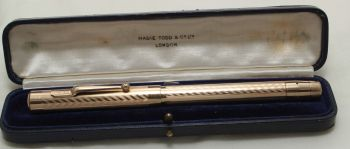 9655 - Swan (Mabie Todd) Self Filling Fountain Pen in Gold Plate. Medium Flex FIVE STAR Nib. Mint and Boxed.