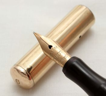 9800 Onoto 2000 series in Black Hard Rubber with a Gold Filled overlay. Superb Medium Flex FIVE STAR Nib.