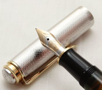 9904 Pelikan M750 Anniversary Fountain Pen in Sterling Silver with Gold filled trim. Medium FIVE STAR Nib.