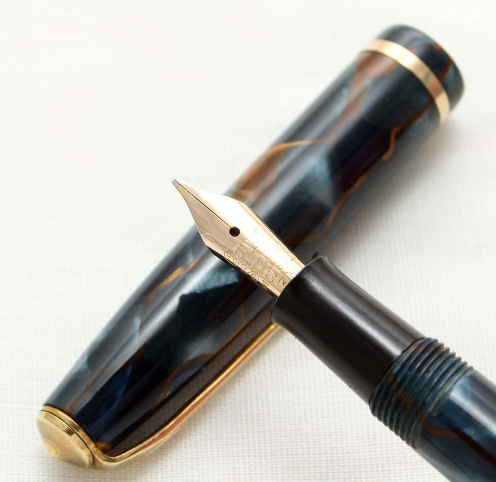 9939 Conway Stewart No.12 in Gold Veined Blue Marble. Medium FIVE STAR Nib.