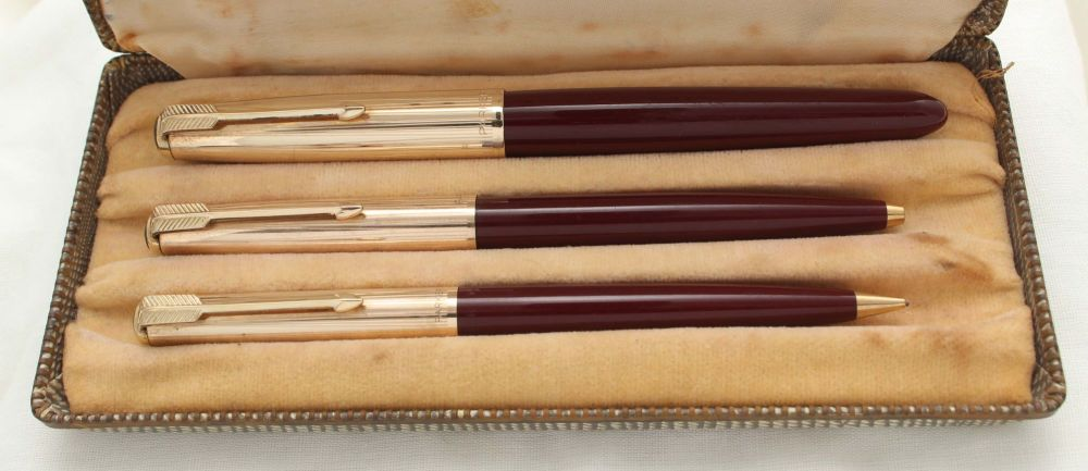 3020 Parker 51 Triple Set in Burgundy with Rolled Gold caps. Mint and Boxed
