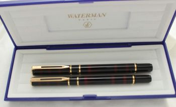 3042 Watermans Laureat Fountain Pen and Rollerball set in Black and Burgundy, Medium Nib. Mint and Boxed.