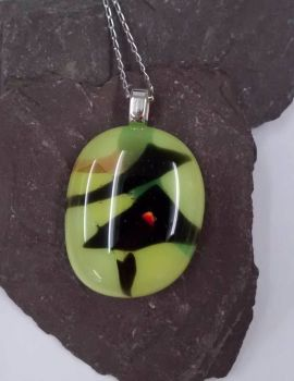 Yellow and black fused glass pendant