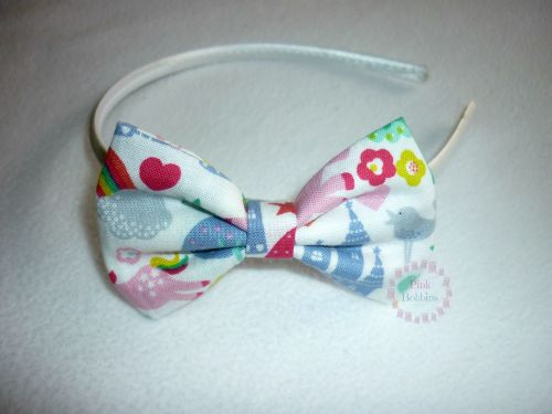 White fantasy (unicorns, rainbows, castles) bow hairband