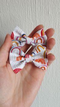 Rainbows on white hair bow - mini, midi or large size - made to order