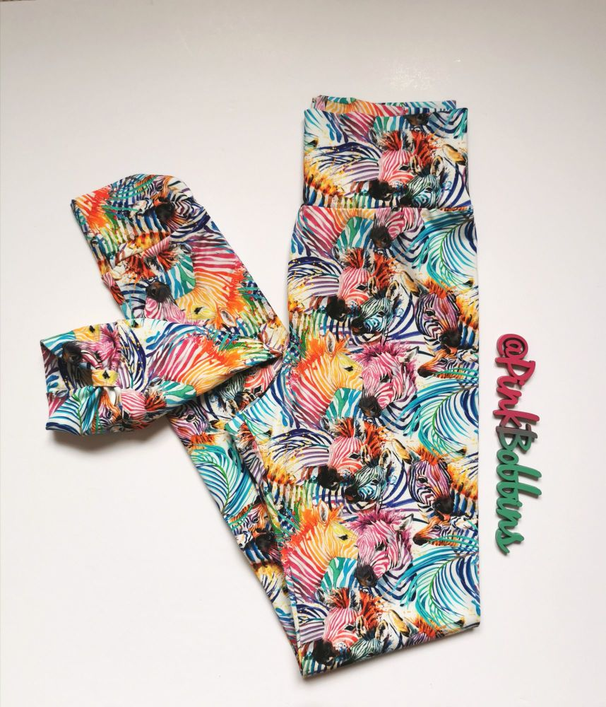 Zebra (multicolour) leggings on navy with optional bow cuffs - made to orde