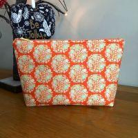 Tilda Flower Nest Ginger zipped bag with striped lining.
