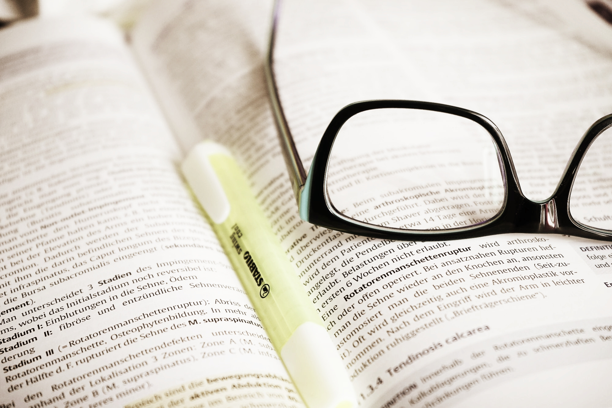 Book, highlighter, glasses