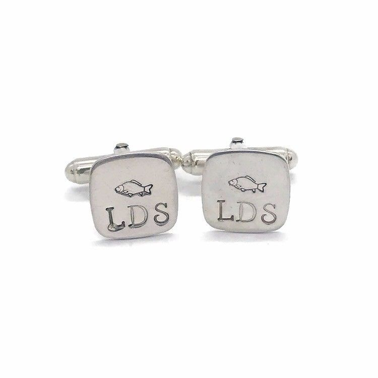 Handmade silver cuff links hand stamped with a fish and initials