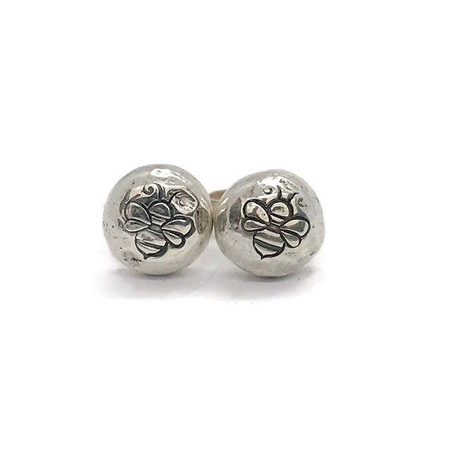 Organic and recycled silver pebble stud earrings with a hand stamped bee