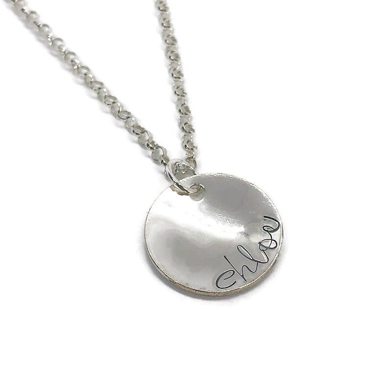 Handmade silver disc necklacewith 'Chloe' hand stamped onto it.