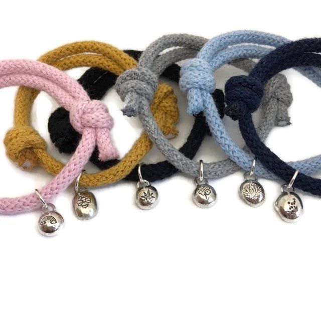 Sliding knot rope bracelets with silver pebble charms hand stamped with designs