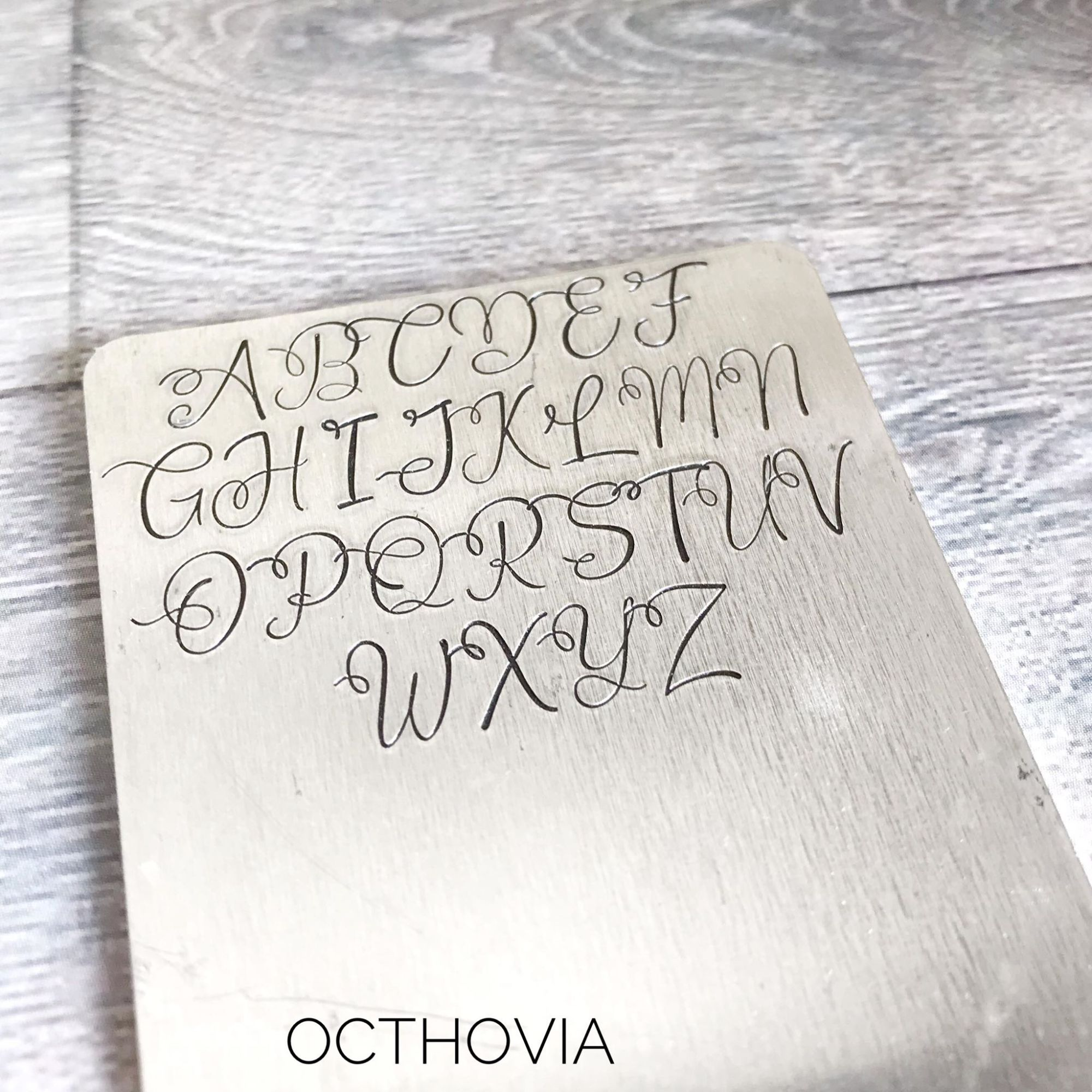 Octhovia metal stamp font