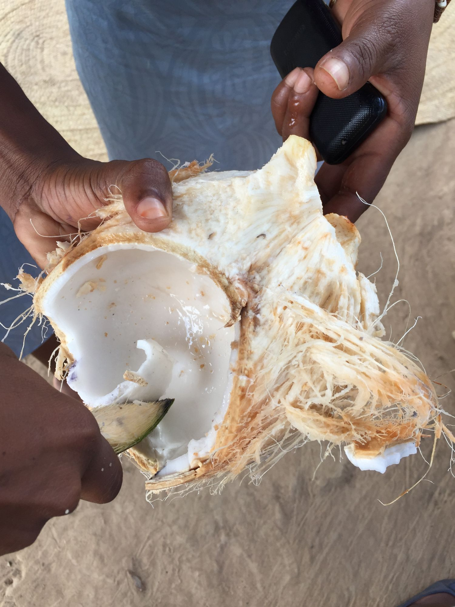 Fresh coconut served by Kelvin's family