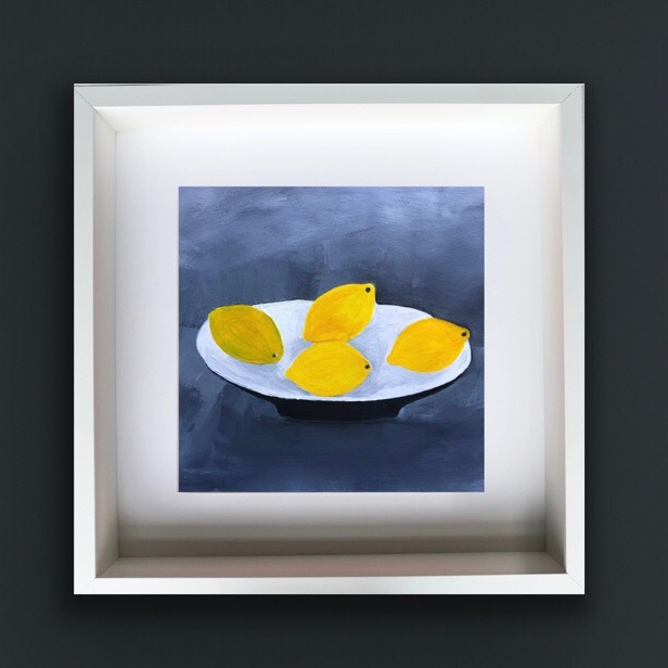 Four Lemons on a White Dish