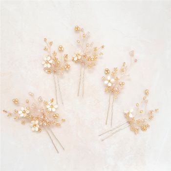 1-ac-3-Esme 2- A mixed size collection of topaz hair pins