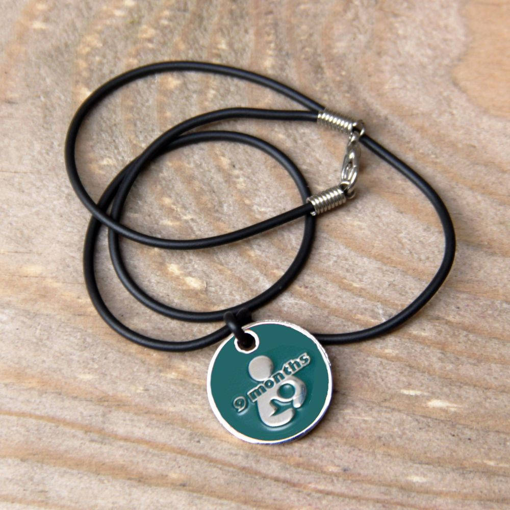 9 month Token with Black Cord Necklace