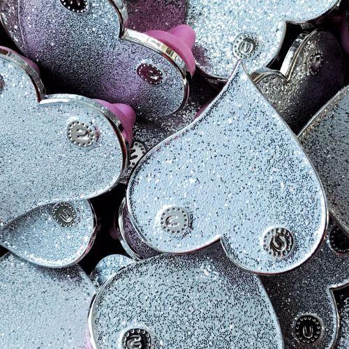 Silver boobie enamel pin badge