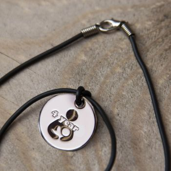 4 year Token with Black Cord Necklace