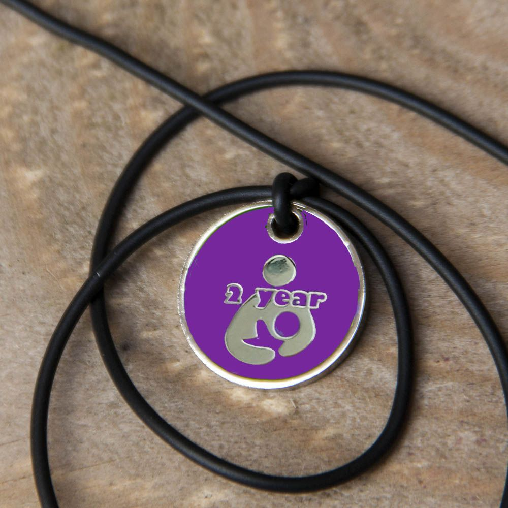 2 year Token with Black Cord Necklace