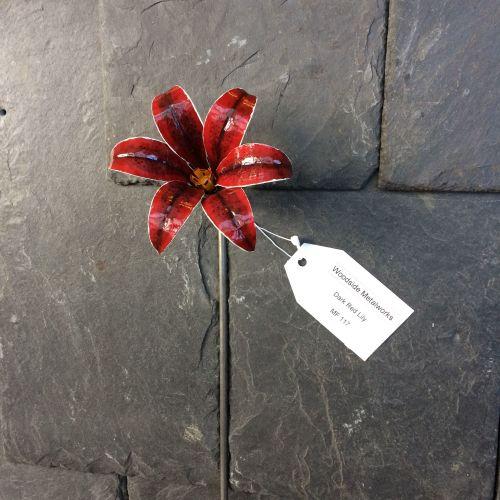 Dark red painted steel stargazer lily