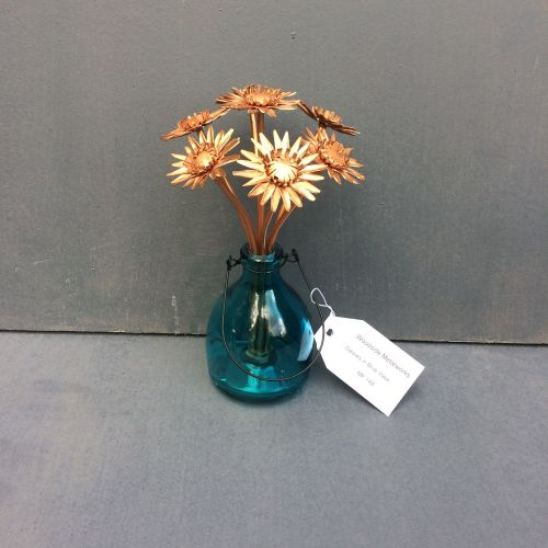 Bunch of copper gerbera daisies arranged in vase
