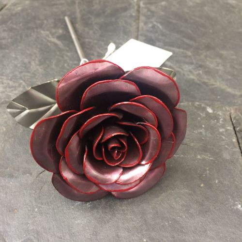 Steel metal rose with a hint of red